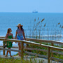 Mom and Daughter Walk off the Beach towards the Beach Club on Kiawah Island